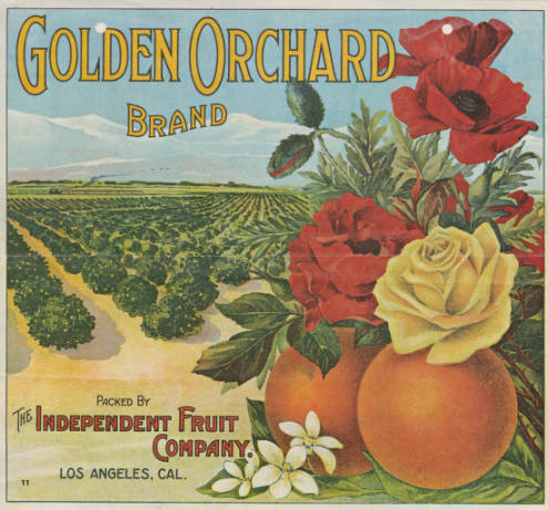 Fruit crate label shows oranges and roses with a crop field in the background