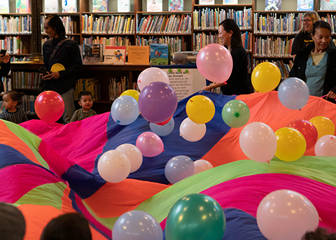 lots of colorful balloons during a library program