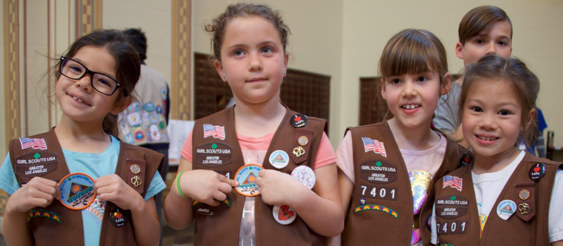 a group of girl scouts during a visit to central library