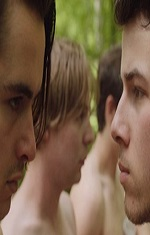 A close up of two young men facing each other.