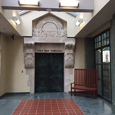 "Lawrie's original gateway to the Children's Garden reads ""The World is my Book"""