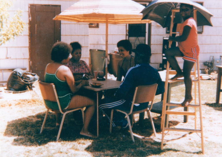 urcey, Oni, Dutch, Al, and young friend at a Fourth of July backyard barbecue.