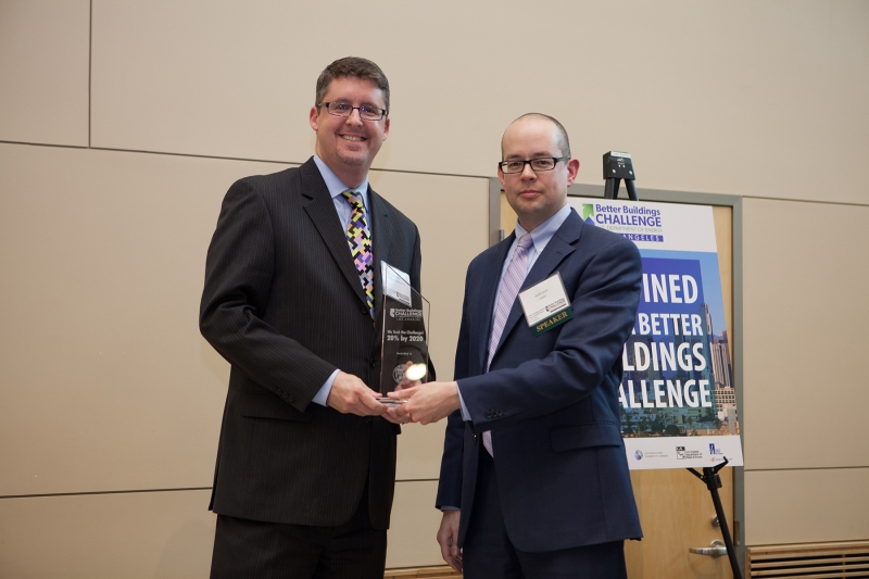 City Librarian John F. Szabo receiving the Energy Innovation Award from David Jacot, Director of Energy Efficiency, Los Angeles Department of Water and Power.