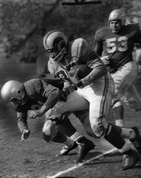 Tank Younger carries the ball for the Los Angeles Rams.