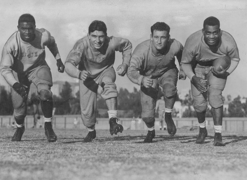 Portrait of four members of the UCLA football backfield including Jackie Robinson (left) and Kenny Washington (right)