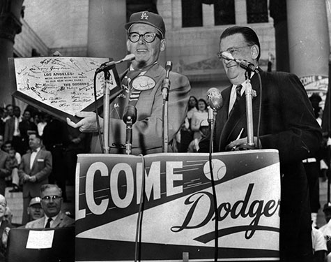 president of the Dodgers presenting home plate to mayor