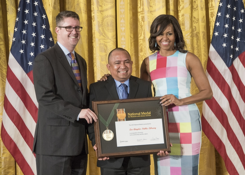City Librarian John F. Szabo, Los Angeles community member Sergio Sanchez and First Lady Michelle Obama