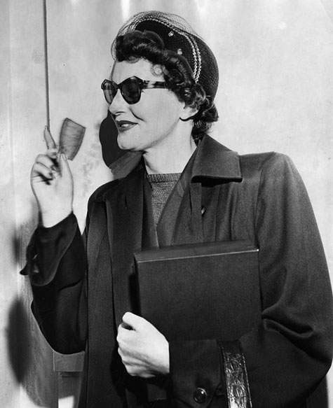 July 11, 1951 Brenda Allen kisses her County Jail property slip good-bye