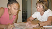 Woman tutoring a teenage girl