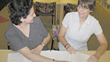 Woman tutoring another woman