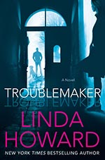 book cover of troublemaker. man stands in doorway as woman leans against wall