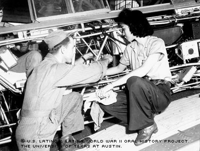Josephine Kelly Ledesma Walker, training another mechanic.  Courtesy of the U.S. Latino & Latina World War II Oral History Project. Retrieved from http://www.womenintexashistory.org/inc/ files/editor/image/learn/Josephine_Kelly_Ledesma_Walker.jpg