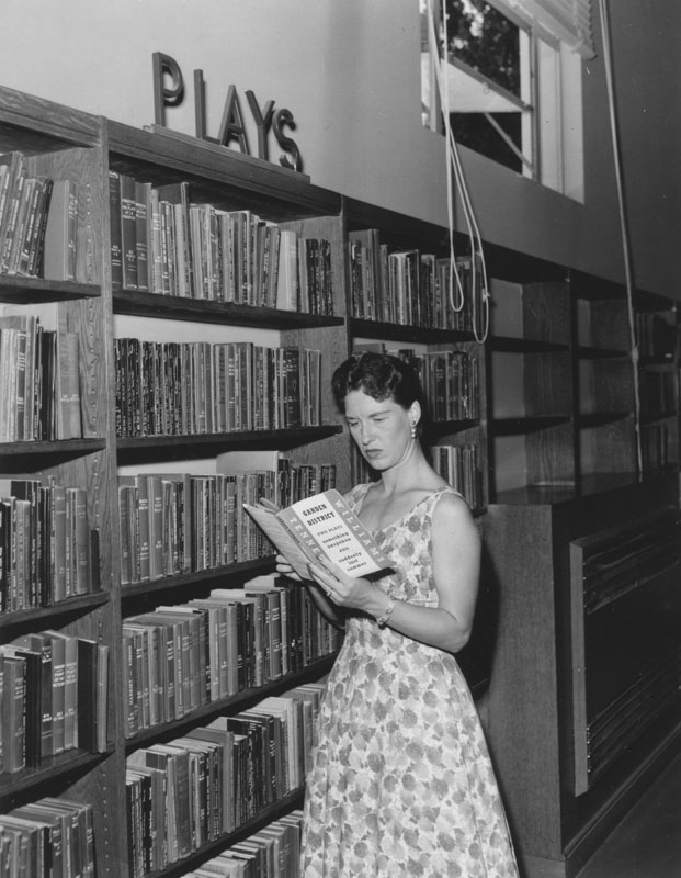 A woman reading Garden District by Tennessee Williams. Central Library's Literature Department, circa 1958. Los Angeles Public Library Photo Collection.