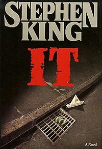 book cover of stephen king's it, an illustration of a sewer drain with a paper boat and a clawed green hand poking through the sewer cover