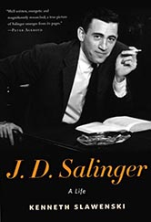 photograph of J.D. Salinger looking into camera with a cigarette in his.  Black and White photo with a slight smile. Photo is several decades old.