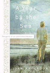 year by the sea book cover.  an illustration of blonde woman in a pantsuit with her back turned, looking out over the ocean.