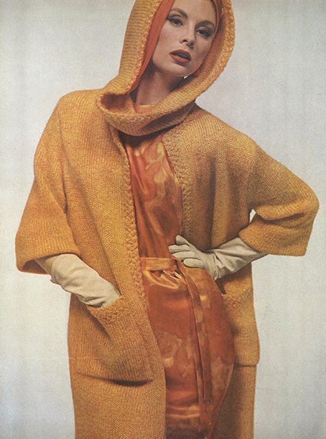 women wearing a hooded orange sweater