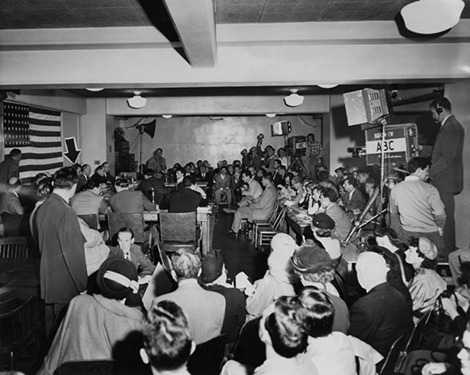 March 23, 1953, in the Los Angeles Federal Building, with KECA-TV crew and Herald Express reporters in attendance