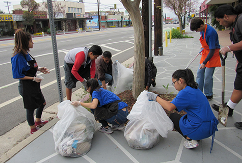 teens cleaning up trash along Reseda Blvd.