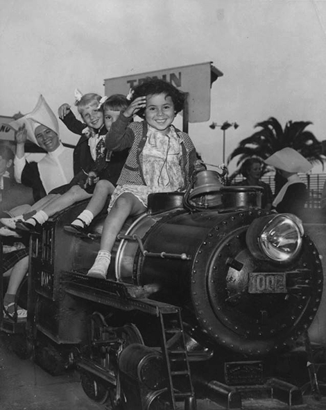 "Orphans take a ride on the ""Bud"" Hurlbut miniature train at Nu-Pike"