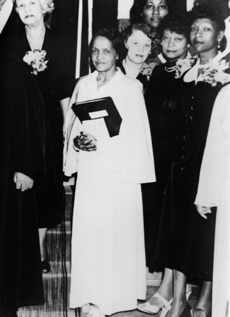 Dr. Maye Jones poses in cap and gown at her graduation in 1957