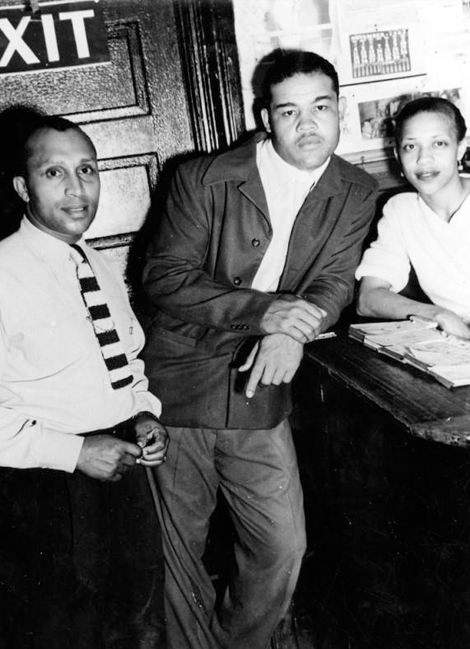 Boxer Joe Louis (center) poses with a woman and Gordon Sheppard in Shepps' Playhouse