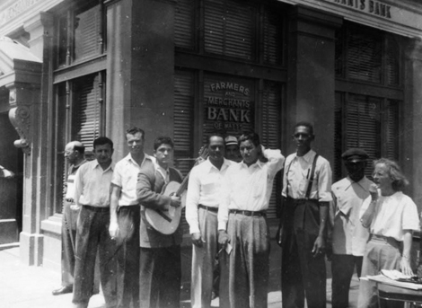 This photo shows the Farmers and Merchants Bank of Watts being picketed in 1948 for not hiring African American or Mexican American tellers