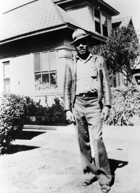 Raymond J. Austin poses in front of his home in Pomona, California, in 1945
