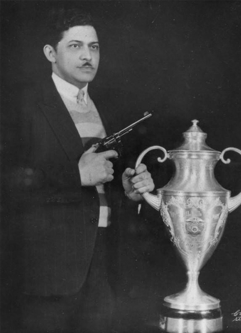 Dr. Eugene poses with his trophy and his weapon in 1935