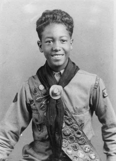 Boy Scout William Legget poses with his merit badges in 1936