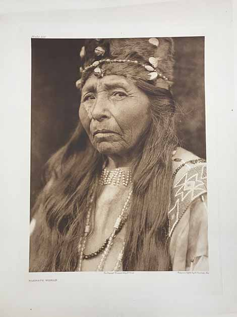 Klamath Woman wearing a crown type of head dress, looking straight into the camera