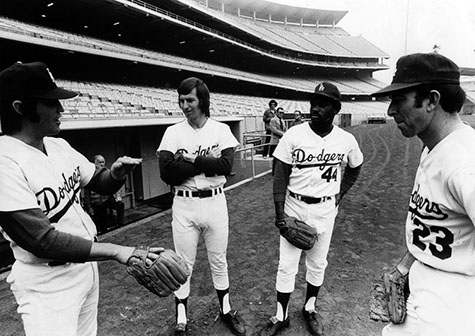 Dodger pitchers Pete Richert, Don Sutton, Al Downing and Claude Osteen take the field.