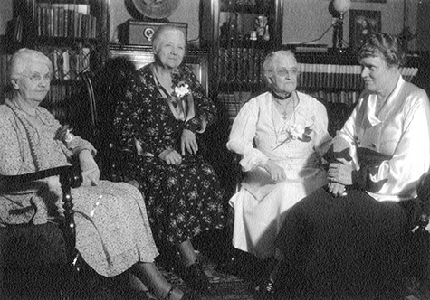4 City Librarians of the Los Angeles Public Library. Left to right: Mary L. Jones, Mary E. Foy, Harriet Child Wadleigh, Althea Warren. Photo taken at the home of Mrs. Wadleigh, 1415 S. Hope St. (April, 1934)