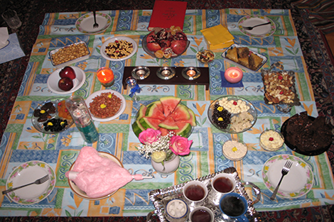 A table cloth with a variety of Yalda favorites taken