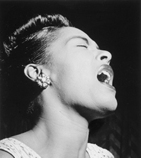 a ide profile black and white photo of a young singing Billie Holiday