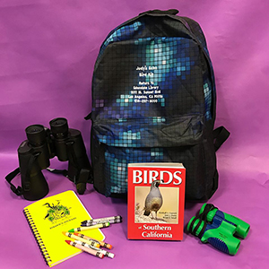 backpack with binoculars and bird book