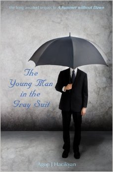 The young man in the gray suit
