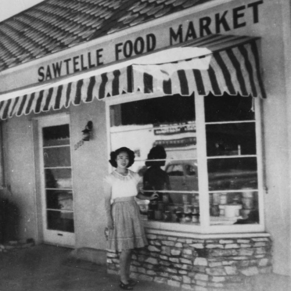 Japanese American woman in front of the Sawtelle Food Market, circa 1947.