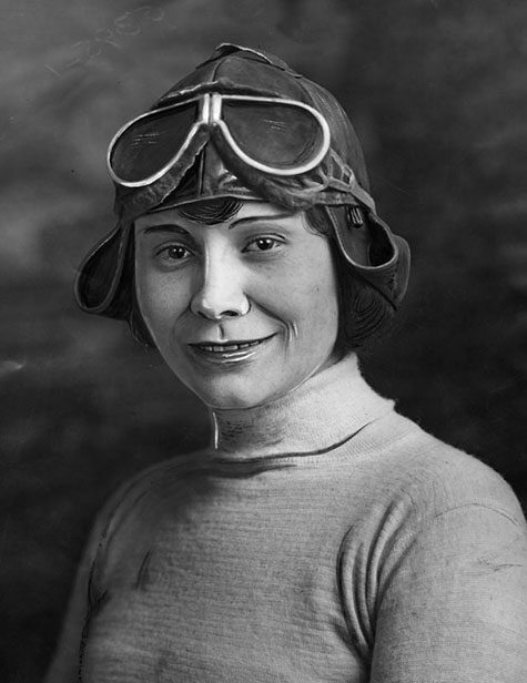 Aviatrix Miss Gladys Roy posing in helmet and goggles