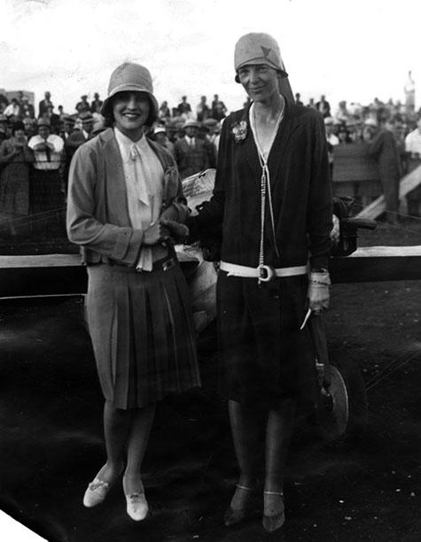 Miss Amelia Earhart (right) and Ruth Elder meet for the first time, 1928 air race.