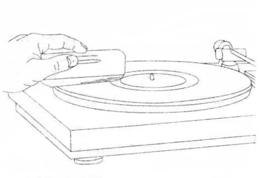 Diagram of vinyl record cleaning process on turntable