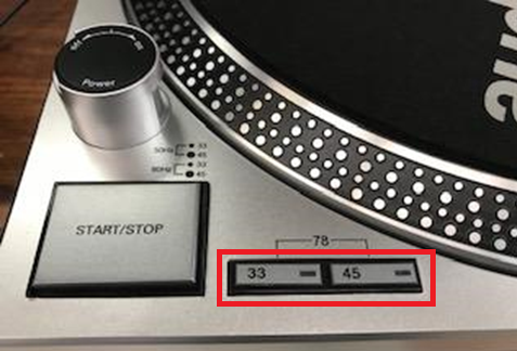 photo demonstrating where the 33 and 45 rpm playback buttons