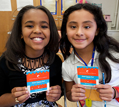 two students holding their student success cards