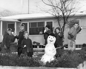 Children building a snowman.