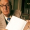 Vladimir Nabokov holding a book of lepidoptery – butterflies