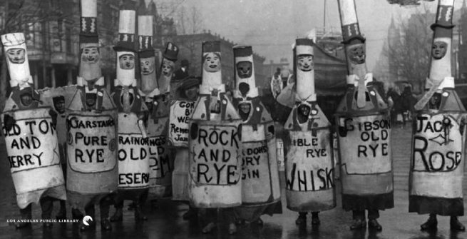 Men dressed as liquor bottles in the Parade of the Departed during the Prohibition.