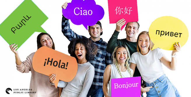 A group holding signs with hello greeting in different languages.