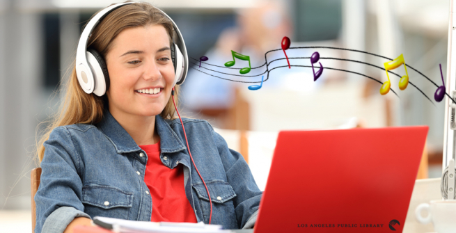 girl with headphones looking at a computer