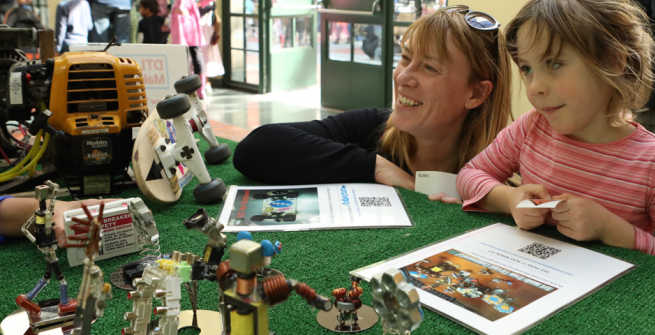 People enjoying the Maker Faire at the library