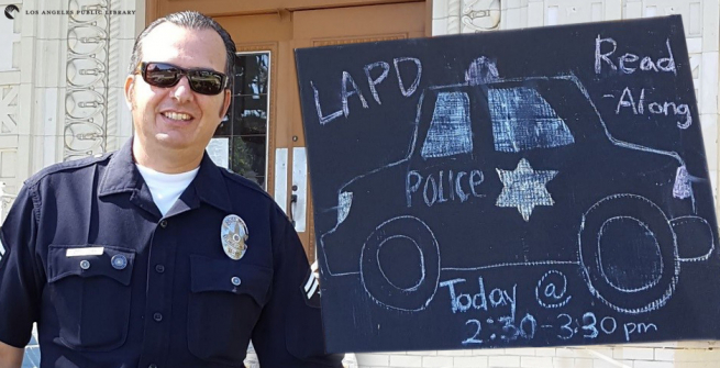Officer Joseph Oseguera in front of the library